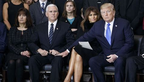 Donald Trump awkwardly touches Mike Pence during memorial