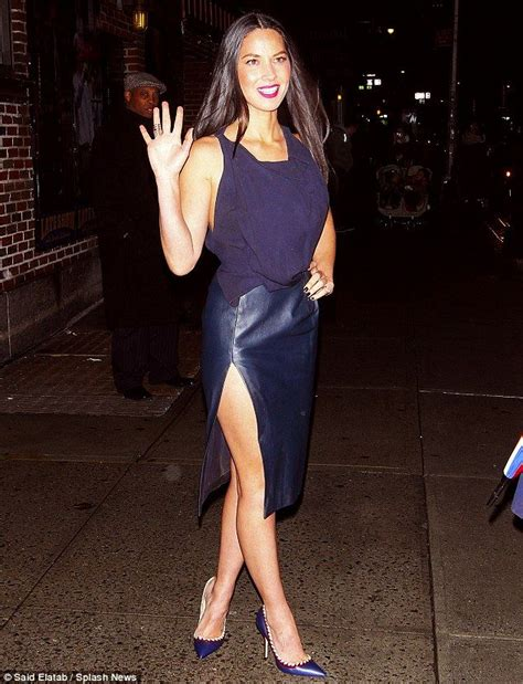 Olivia Munn shows off her legs in tight leather blue skirt